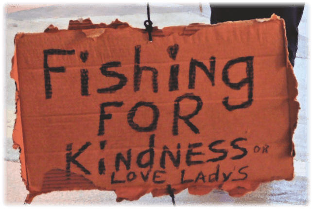 Person on the streets fishing for kindness or love from ladies